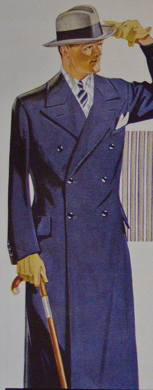 blue-overcoat-with-grey-hat-scarf-sand-gloves